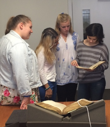 Holding a 18C copy of Shakespeare's 'Henry the IV'