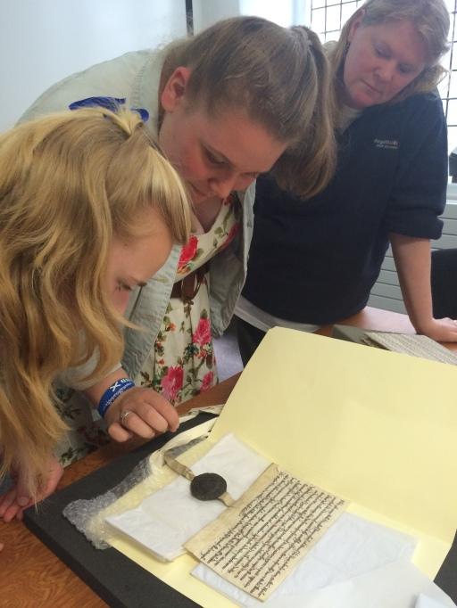 Katrina and Emilie touch a St Leonards college pittance writ dated 1215.