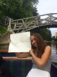 A scale drawing of the Mathematical Bridge and the real thing in the background