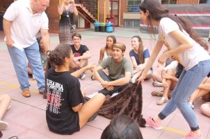 "Students learn each other's names during the ""blanket game."""