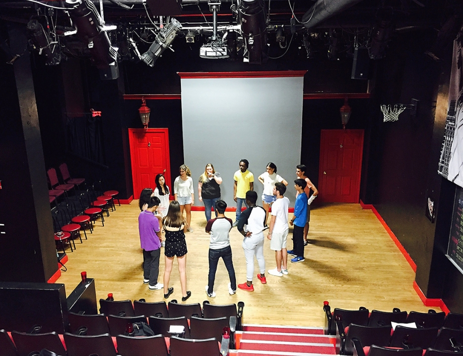 Students performing group exercises in the Peoples Improv Theater during their Speech and Debate minor.