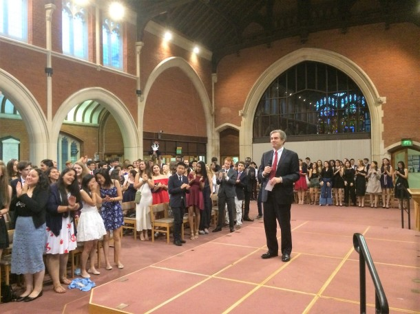 Founder Jim Basker leads the students in a standing ovation for the faculty.